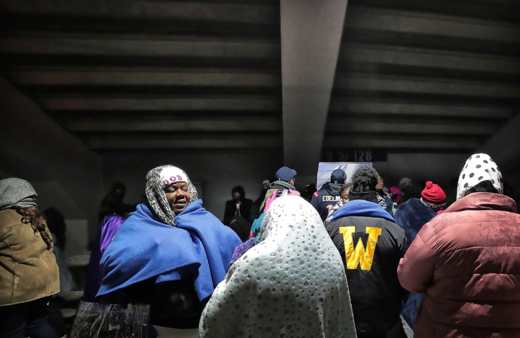 <strong>Fans huddle under the bleachers during halftime to stay out of the cold rain at the home opener of Memphis' Alliance of American Football league team at the Liberty Bowl on Feb. 16.</strong> (Jim Weber/Daily Memphian)
