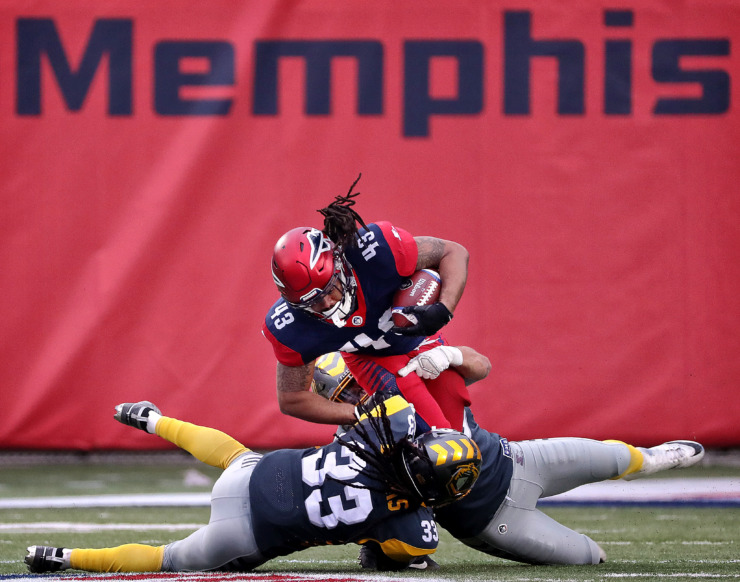 <strong>Memphis Express running back Terrence Magee (43) is taken down for a short gain against the San Diego Fleet during their Alliance of American Football league game at the Liberty Bowl on March 2.</strong> (Jim Weber/Daily Memphian)