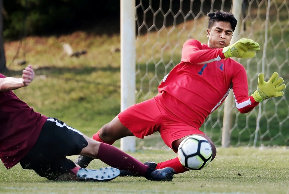 <strong>Lausanne goalie Suneil Patel blocks a shot by Brandon Brackett from ECS during their Div 2 semifinal game at St. George's in Collierville on May 7, 2019.</strong> (Jim Weber/Daily Memphian)