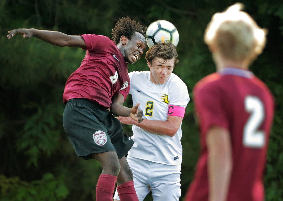 <strong>Kuku Kumtor from ECS leaps for a header against Lausanne's Kestrel Strom during their Div 2 semifinal game at St. George's in Collierville on May 7, 2019.</strong> (Jim Weber/Daily Memphian)