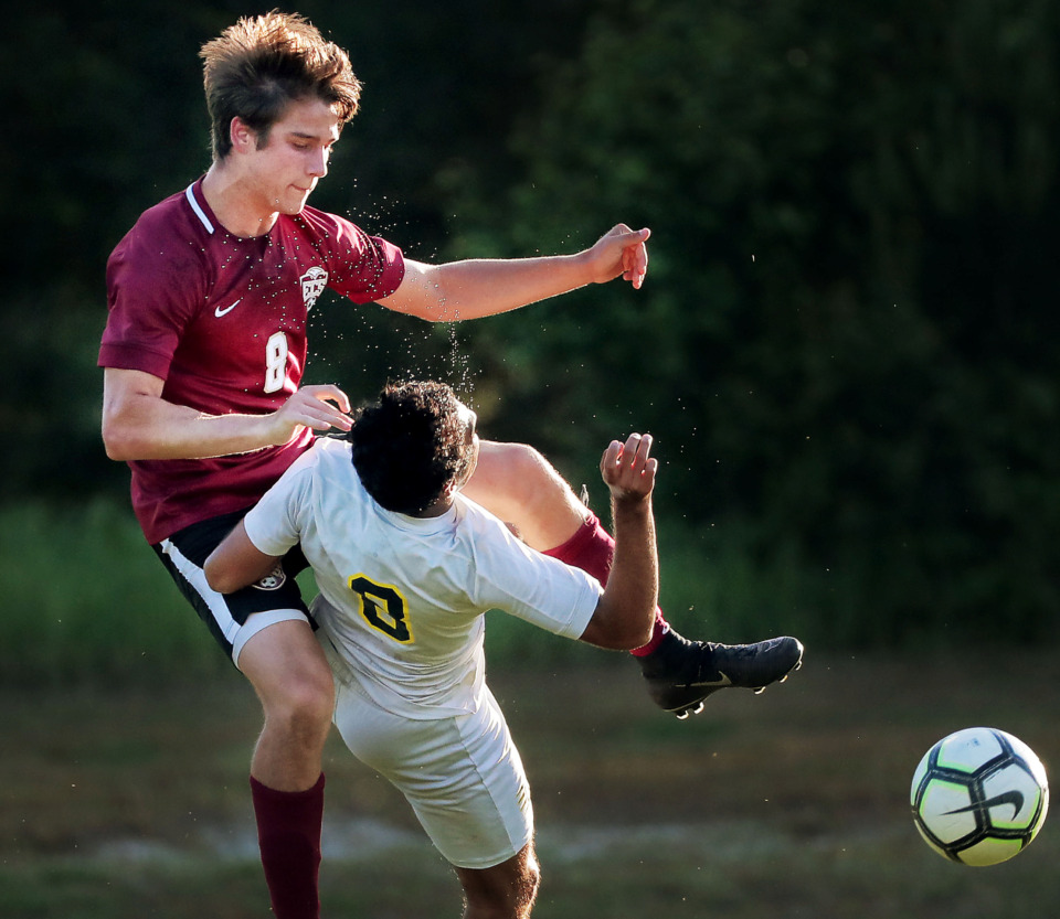 <strong>Carson Gagnon from ECS colliedes midair with Lausanne's Kelvin Borges during their Div 2 semifinal game at St. George's in Collierville on May 7, 2019.</strong> (Jim Weber/Daily Memphian)