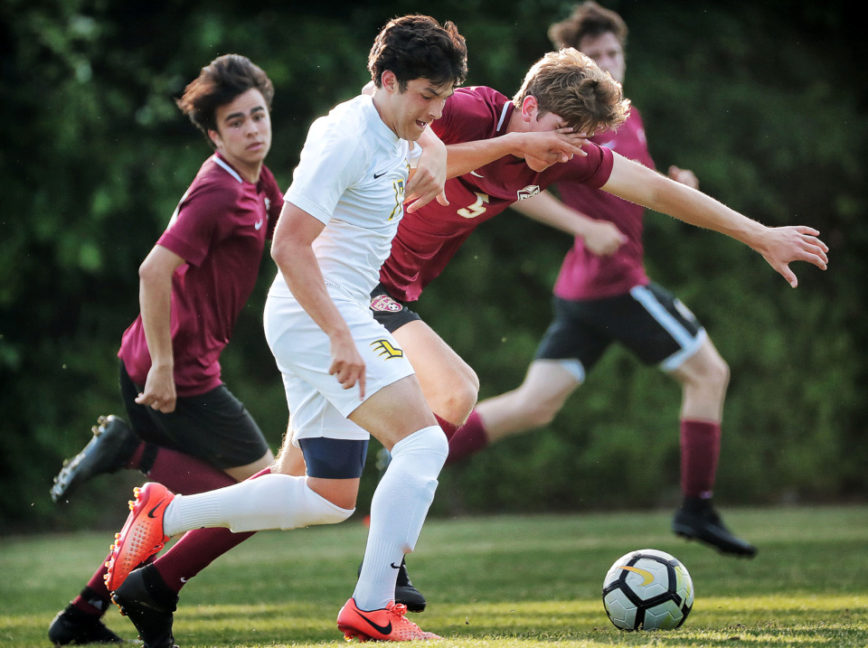 <strong>Lausanne's Vinny Garcia (17) battles for control of the ball with Evan Stookey from ECS during their Div 2 semifinal game at St. George's in Collierville on May 7, 2019.</strong> (Jim Weber/Daily Memphian)