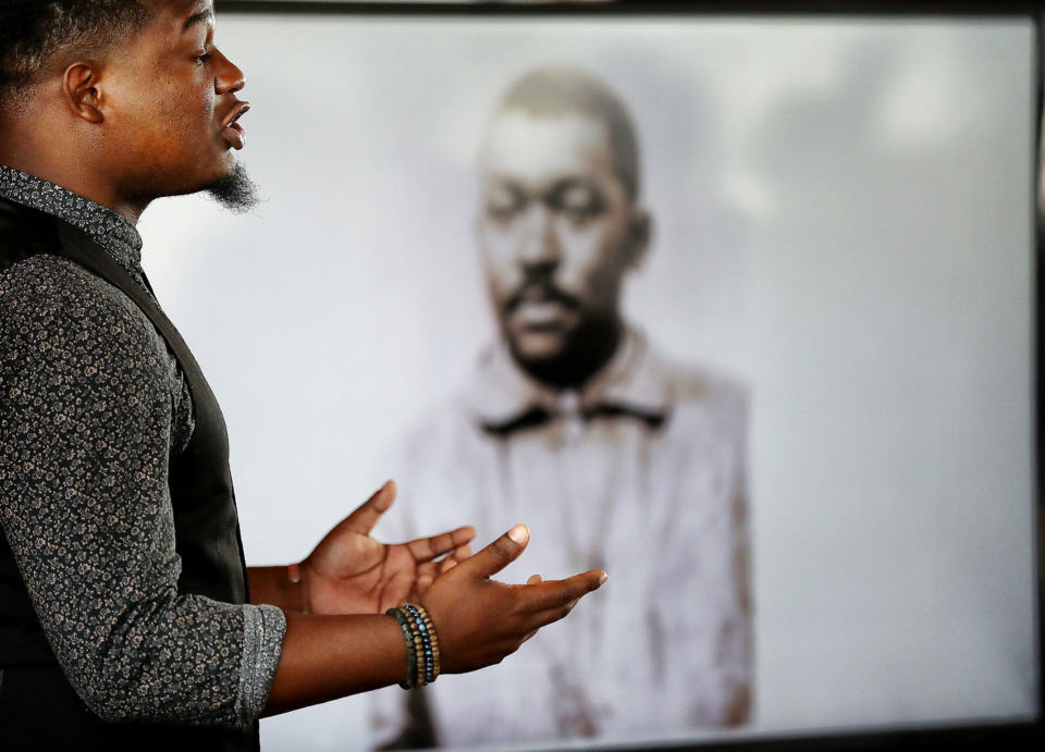 <strong>Poet Sebastian Carson performs a work honoring Tom Lee during a gathering at Beale Street Landing to honor the Memphis hero who rescued 32 people from the Mississippi River 94 years ago. The gathering on May 8, 2019, brought together his descendants with those who had a connection to some of the people he rescued in 1925.</strong> (Jim Weber/Daily Memphian)