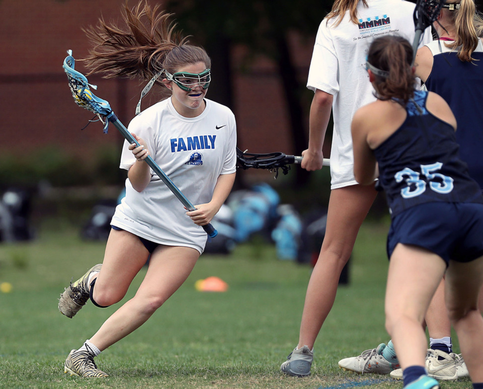 <strong>St. Mary's Episcopal School senior Becca Stutzberg cuts in between several defenders on a scoring run during a Wednesday, May 8, 2019 practice.</strong> (Patrick Lantrip/Daily Memphian)