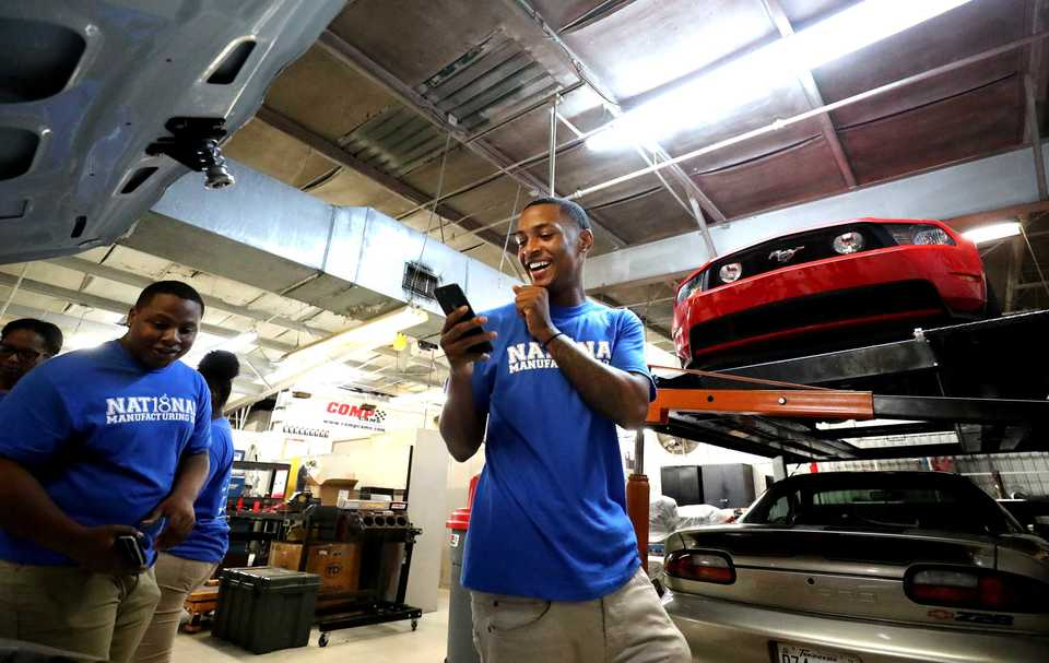 <strong>Bolton High School senior Crishon Moore takes photos of an engine that Competition Cams helped build. Bolton High School joined other Shelby County Schools in celebrating Manufacturing Day by visiting an advanced manufacturing facility in Memphis.</strong> (Houston Cofield/Daily Memphian)