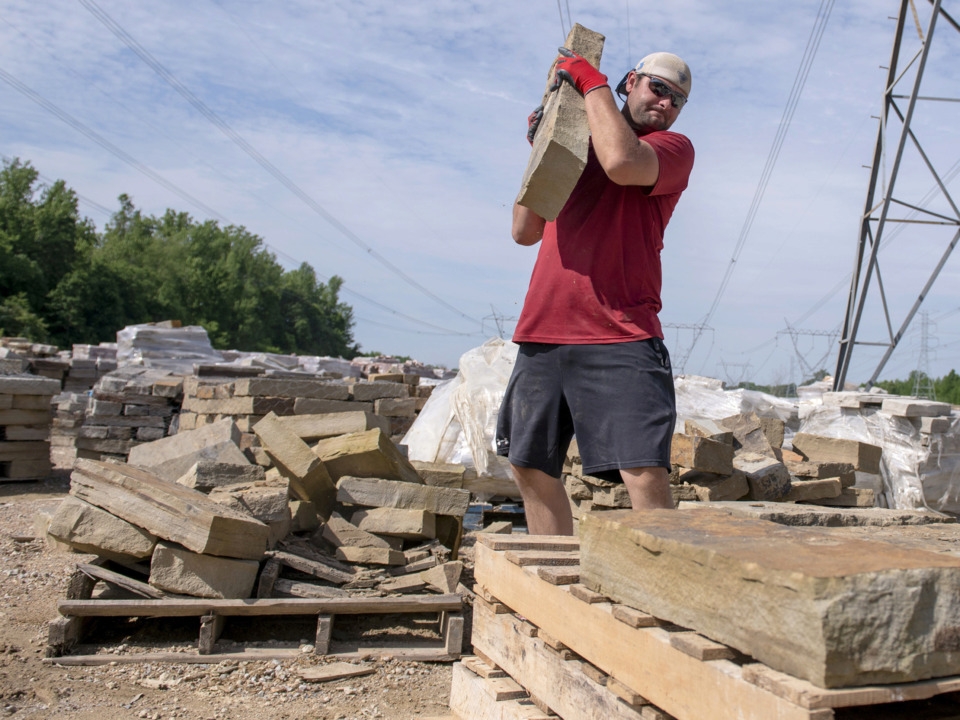 <strong>Justin Sechrest stacks Oklahoma Blue Brown stone at Christie Cut Stone on May 8, 2019 in Memphis, Tenn.</strong> (Brandon Dill/Special to The Daily Memphian)