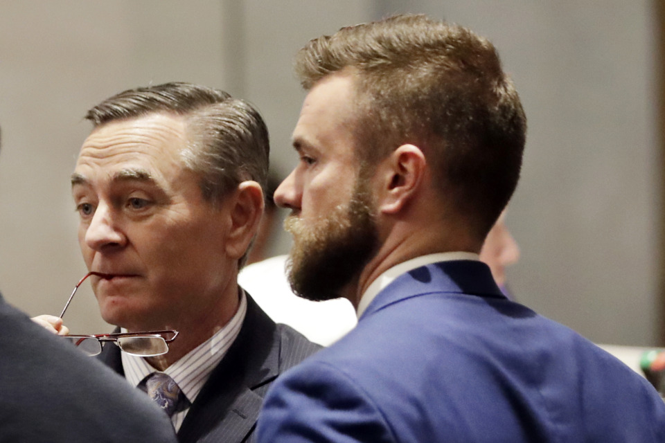 <strong>House Speaker Glen Casada, R-Franklin (left) talks with Cade Cothren (right), his chief of staff, during a House session on May 2, 2019, in Nashville. Cothren has resigned amid allegations of racist and sexually explicit texts.</strong> (AP file photo/Mark Humphrey)