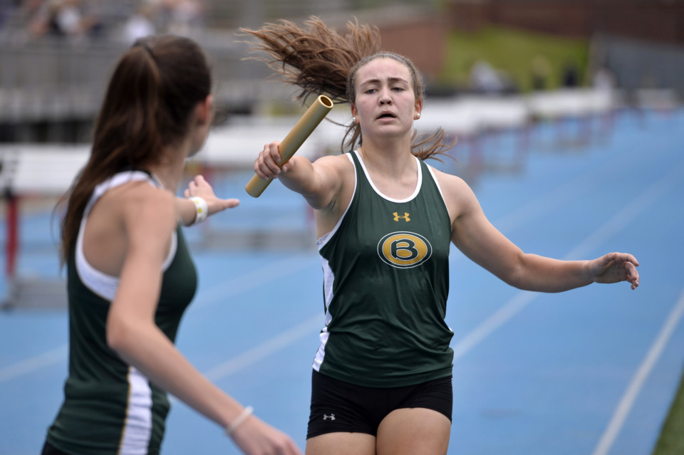 <strong>Briarcrest's Caroline Pierce hands off the baton to Kat Harris in the 4x800 meter relay race during Division 2 track finals at Memphis University School on May 9, 2019.</strong> (Brandon Dill/Special To The Daily Memphian)