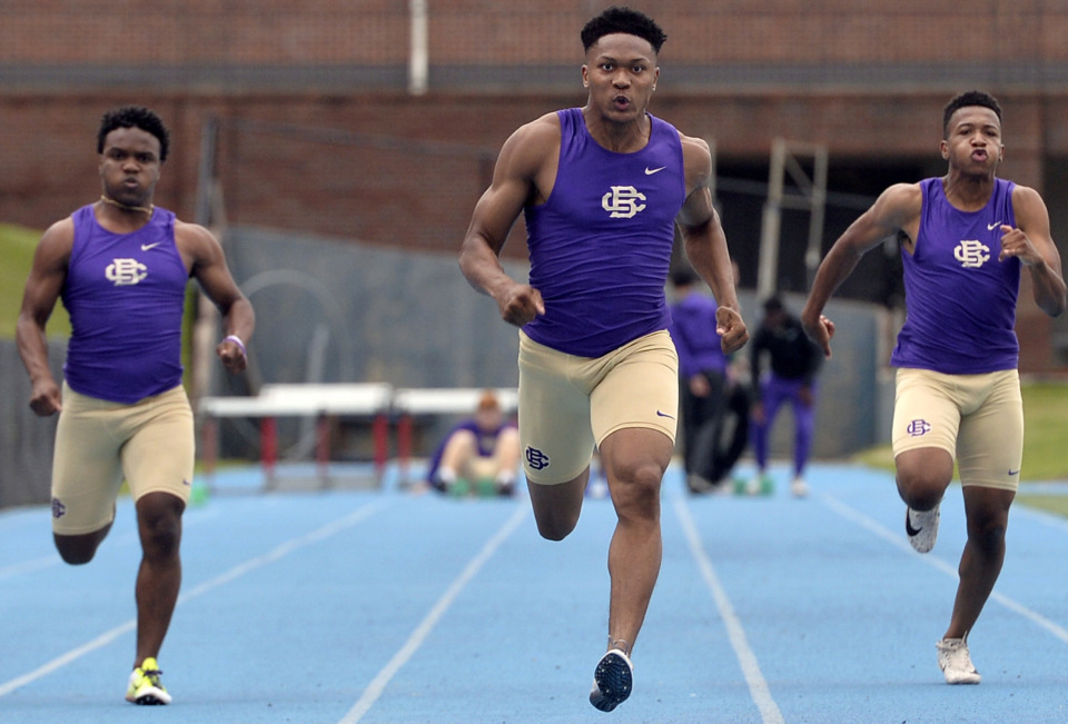 <strong>Christian Brothers High School's Antonio Lay (center) pulls ahead of teammates Will Ruth (left) and Conner Goodrich on his way to setting a new school record of 10.591 seconds in the 100 meter dash during Division 2 track finals at Memphis University School on May 9, 2019.</strong> (Brandon Dill/Special To The Daily Memphian)