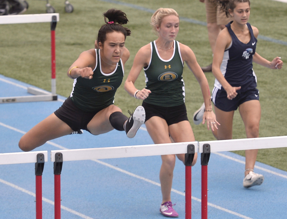 <strong>Briarcrest's Michella Diebenow (center) pulls away from the pack to win the 100 meter hurdles race during Division 2 track finals at Memphis University School on May 9, 2019.</strong> (Brandon Dill/Special To The Daily Memphian)