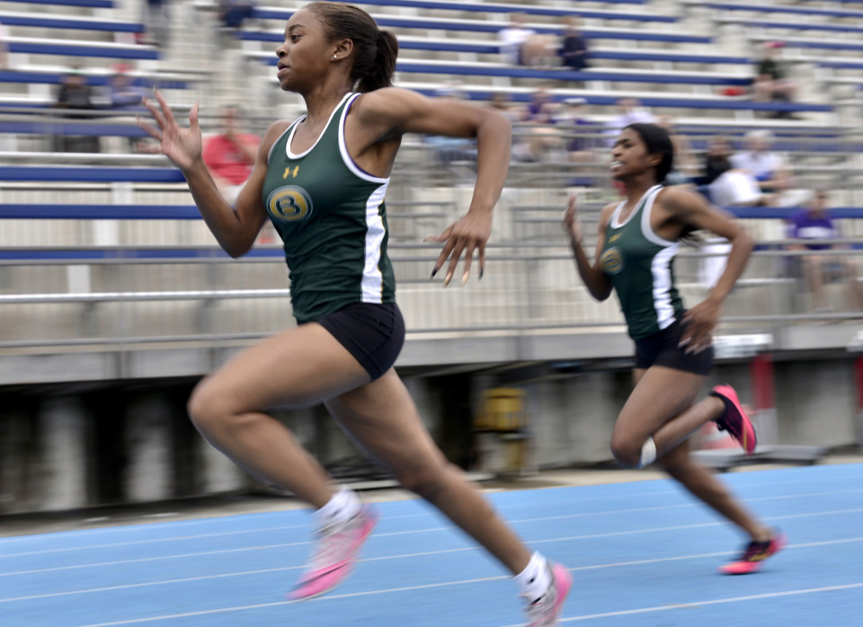 <strong>Briarcrest's Kynnidi Caffey (left) and Lyndsey Herron compete in the women's 100 meter dash during Division 2 track finals at Memphis University School on May 9, 2019.</strong> (Brandon Dill/Special To The Daily Memphian)