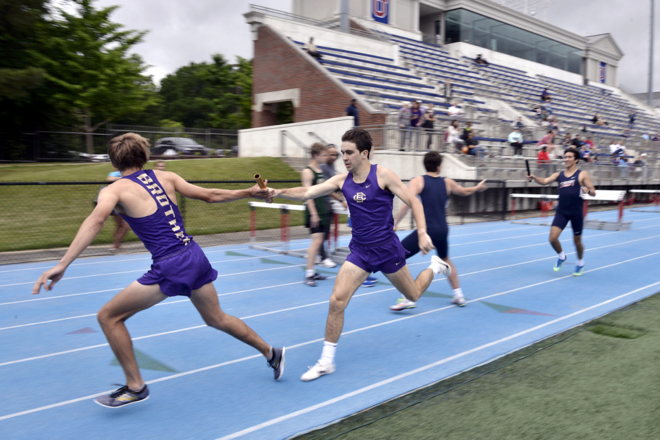 <strong>Christian Brothers High School's Sloan McHugh passes the baton to Baker Springer on their way to placing first in the men's 4x800 meter relay race during Division 2 track finals at Memphis University School on May 9, 2019.</strong> (Brandon Dill/Special To The Daily Memphian)