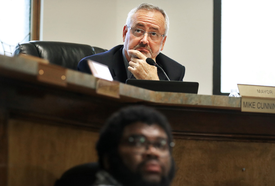 <strong>Lakeland Mayor Mike Cunningham (above) and Finance and Human Resources Director Kyle Wright listen to details about the Lakeland Commons project during a Lakeland Board of Commissioners meeting on May 9, 2019, at Lakeland City Hall where commissioners approved the new mixed-use project.</strong> (Jim Weber/Daily Memphian)