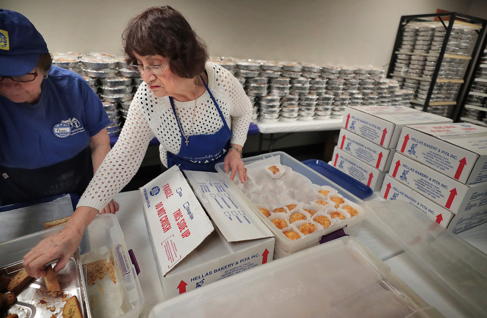 <strong>Anna Denton and Odette Patrikios (left) make a tray of assorted pastries as volunteers hurry to finish preparations for the annual Greek Festival at Annunciation Greek Orthodox Church on May 10, 2019. The Greek Fest runs Friday and Saturday from 11 a.m. to 8 p.m. with a variety of Greek food, live entertainment and vendors.</strong> (Jim Weber/Daily Memphian)