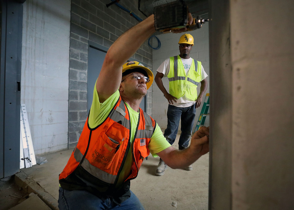 <strong>Michael Finley (left) and Lawrence Springfield (right) install a doorframe on Tuesday, May 7, 2019 at Bill's Place, a $22 million expansion of Youth Villages' Bartlett, Tennessee campus.</strong> (Patrick Lantrip/Daily Memphian)