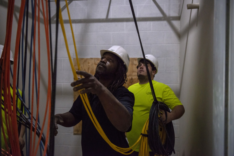 <strong>Cyber Technology Security employees Michael Wright (left) and Matt Croy install cable at the construction site of Forest Hill Elementary School May 8, 2019, in Germantown.</strong> (Brandon Dill/Special To The Daily Memphian)