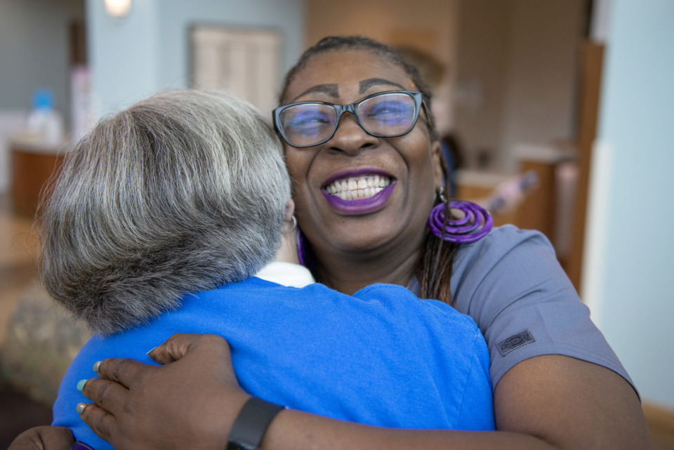 <strong>Retired nurse Jane Burlingham (left) hugs nursing obstetrics technician Karolyn Bryant as they gather with other nursing staff for a photo at Methodist Le Bonheur Germantown Hospital on Friday, May 10. This Mother's Day, the hospital will celebrate the 25th anniversary of the opening of its maternity ward.</strong> (Brandon Dill/Special to The Daily Memphian)
