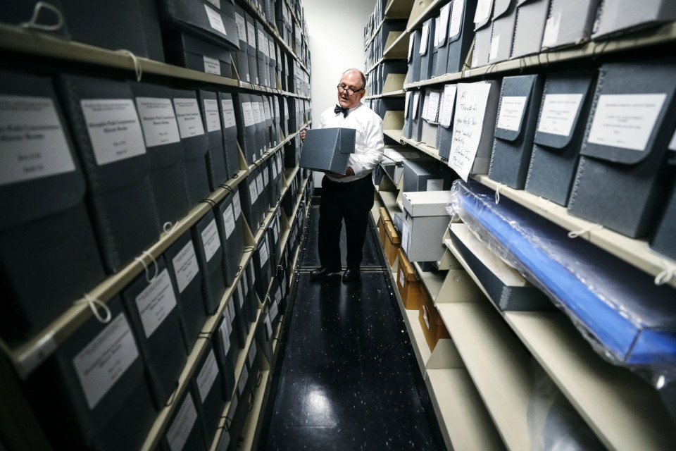 <strong>Wayne Dowdy, manager of the Memphis Public Library and Information Center's history department, retrieves Memphis Police Department case files dating back to 1917. Dowdy has been working with his colleague Gina Cordell to preserve the files and provide new leads on unsolved murders.</strong> (Houston Cofield/Daily Memphian)