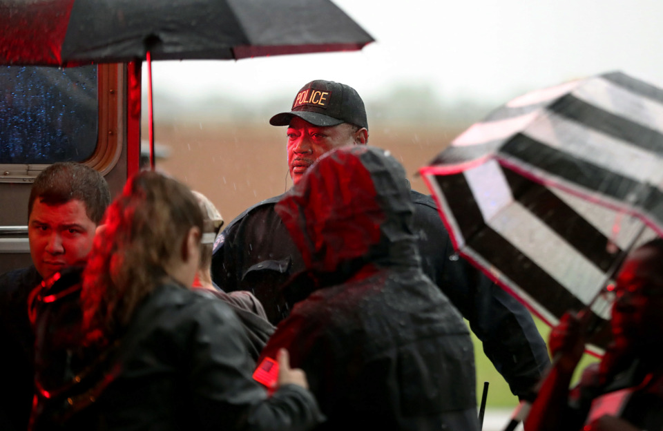 <strong>Sergeant Kenneth King (center)&nbsp; with the University of Tennessee Health Science Center's campus police assists firefighters with getting a patient who was injured during a rainy-day fall into the back of an ambulance on Thursday, May 9, 2019.</strong> (Patrick Lantrip/Daily Memphian)