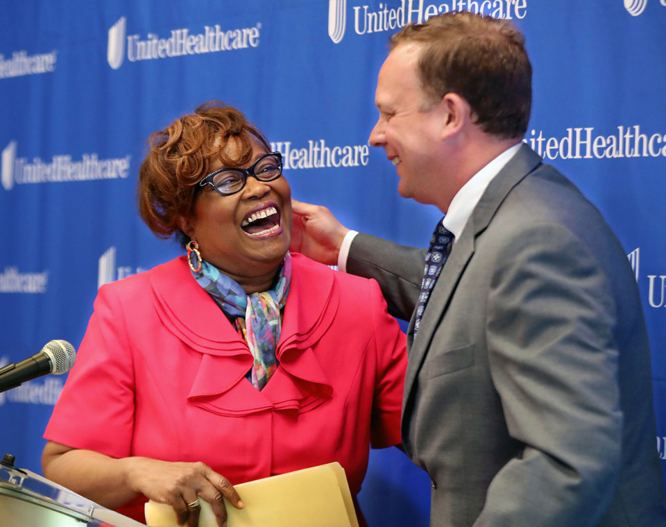 <strong>Beverly Robertson, named president and CEO of the Greater Memphis Chamber greets Steve Wilson, Commercial CEO, Tennessee, Arkansas, southwest Virginia at UnitedHealthcare as he walks up to the podium Monday, May 13, 2019.</strong> (Patrick Lantrip/Daily Memphian)