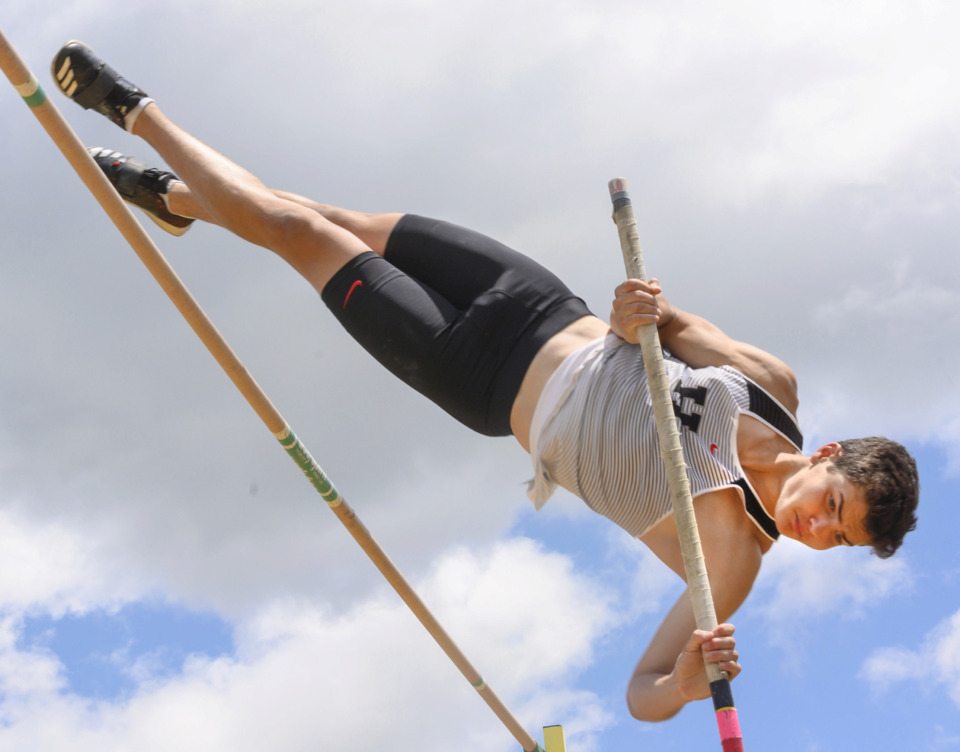 <strong>Houston High's Liam Jogal easily clears the bar and wins first place in the boys pole vault at the 4-AAA sectional track meet Monday, May 13, 2019, at Arlington High School.</strong> (Greg Campbell/Special to The Daily Memphian)