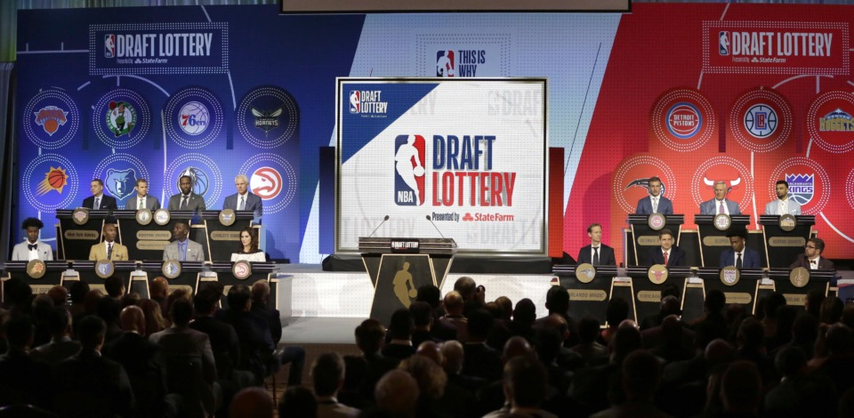 <span><strong>NBA team representatives participating in the NBA basketball draft lottery sit on stage Tuesday, May 15, 2018, in Chicago.</strong> (AP Photo/Charles Rex Arbogast)</span>