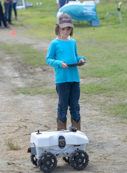 <strong>Hannah Nelson, 8, drives a robot from EarthSense during field day at Davos on the Delta Monday, May 13, 2019 at the Agricenter.</strong> (Greg Campbell/Special to The Daily Memphian)