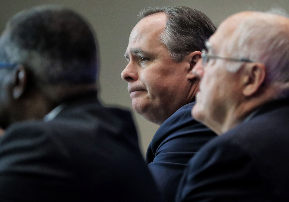 <strong>University of Memphis President David Rudd (center) defers questions about the resignation of Athletic Director Tom Bowen during a press conference alongside new interim AD Allie Prescott (right) and trustee Cato Johnson at the Laurie-Walton Family Basketball Center on May 14, 2019.</strong> (Jim Weber/Daily Memphian)