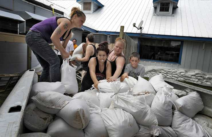 <strong>Krystal Day, of Homosassa, Fla., left, leads a sandbag assembly line at the Old Port Cove restaurant Tuesday, Oct. 9, in Ozello, Fla. Employees were hoping to protect the restaurant from floodwaters as Hurricane Michael continues to churn in the Gulf of Mexico heading for the Florida panhandle.</strong> (Chris O'Meara/Associated Press)