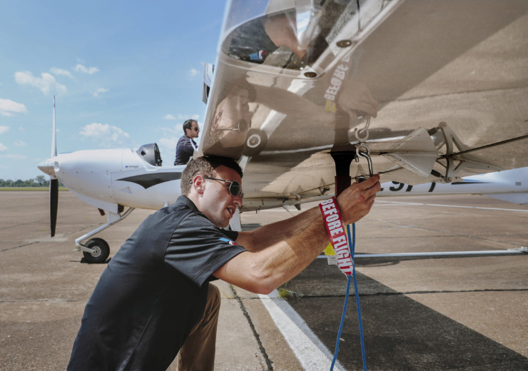 <strong>David Johnson (front) works with flight trainer Jonathan Du Vivier to tie down an airplane after running at test flight at the CTI Professional Flight Training facility at Memphis-Millington Airport on August 14, 2018. The former Memphis Naval Air Station airfield won a $10 million federal grant for runway rehabilitation.&nbsp;</strong>(Houston Cofield/Daily Memphian file)