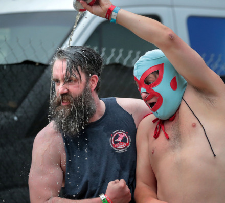<strong>Sauce wrestlers Matt Butler (left) with the Pigs In Gin team and Ben Keras clown around after the sauce wrestling was postponed due to poor weather during the first day of the 2019 Memphis in May World Championship Barbecue Cooking Contest on May 15, 2019, at Tom Lee Park.</strong> (Jim Weber/Daily Memphian)