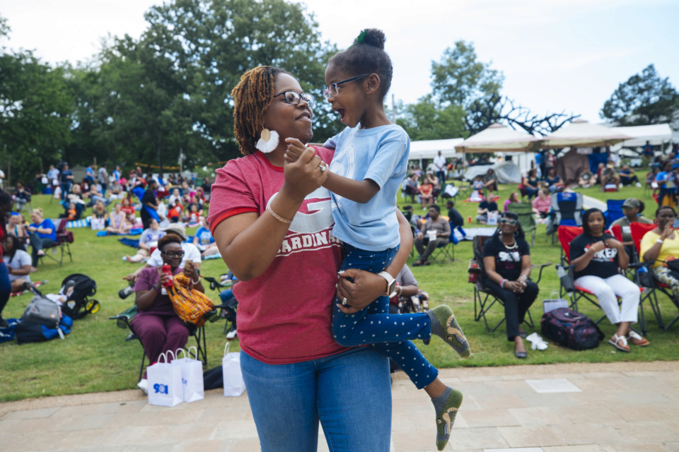 "<strong>Mother and daughter Patricia and Eve Lockhart dance among the crowd at Shelby County Schools' ""SCS is 901"" rally Wednesday, May 15, 2019, at Levitt Shell in Overton Park.&nbsp;</strong>(Ziggy Mack/Special to The Daily Memphian)"