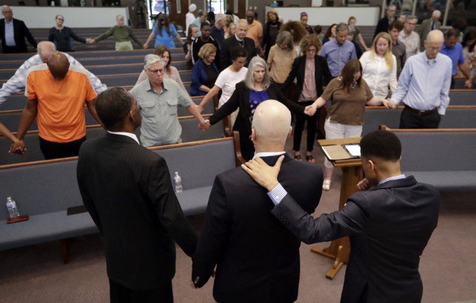 <strong>People pray during a vigil for Donnie Johnson at Riverside Seventh-Day Adventist Church, Thursday, May 16, 2019, in Nashville, Tenn. Johnson was executed Thursday for suffocating his wife, Connie Johnson, in a Memphis camping center he managed in 1984. The vigil was held at the church where Johnson served as an elder while in prison, though he was never able to visit the church.</strong> (AP Photo/Mark Humphrey)