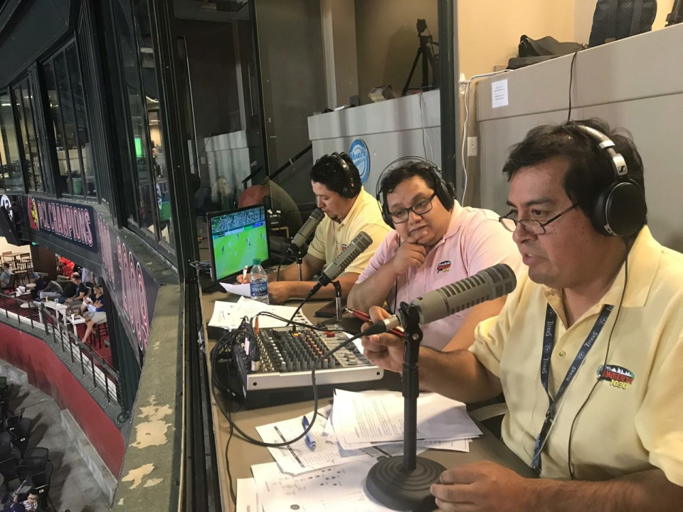<strong>Announcers call a Memphis 901 FC game for La Jefa 99.3, the only radio station carrying the team's games &ndash; home and away. Memphis' USL team has made a concerted effort to build bridges with the local Latino community.&nbsp;</strong>(Photo courtesy of Butron Media Corp.)