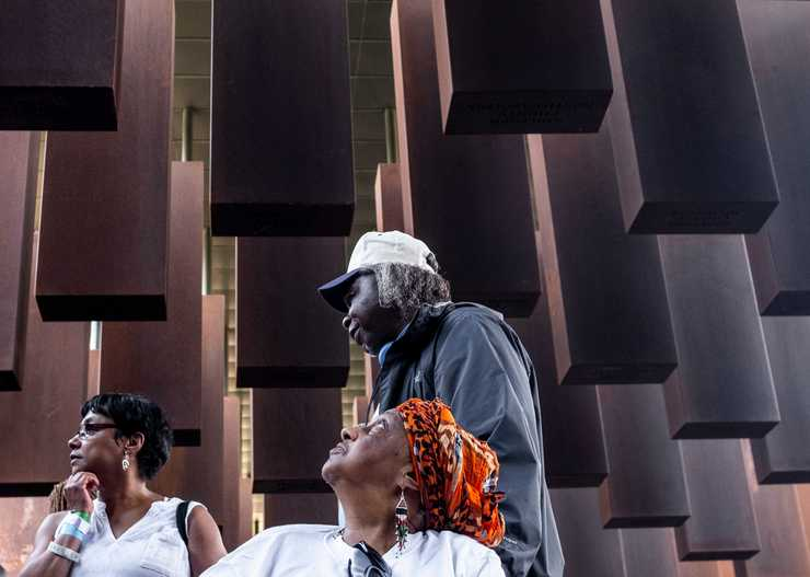 <strong>Duluth, Minn., residents Kim Green, left, Portia Johnson, center and Ronnie Wells take in the National Memorial for Peace and Justice in Montgomery, Ala. on Friday, April 27, 2018. They were among the nearly three dozen Minnesotans who took a 98-hour bus trip to be among the first to tour the memorial and attend the museum's opening.</strong> (Evan Frost/Minnesota Public Radio via AP)