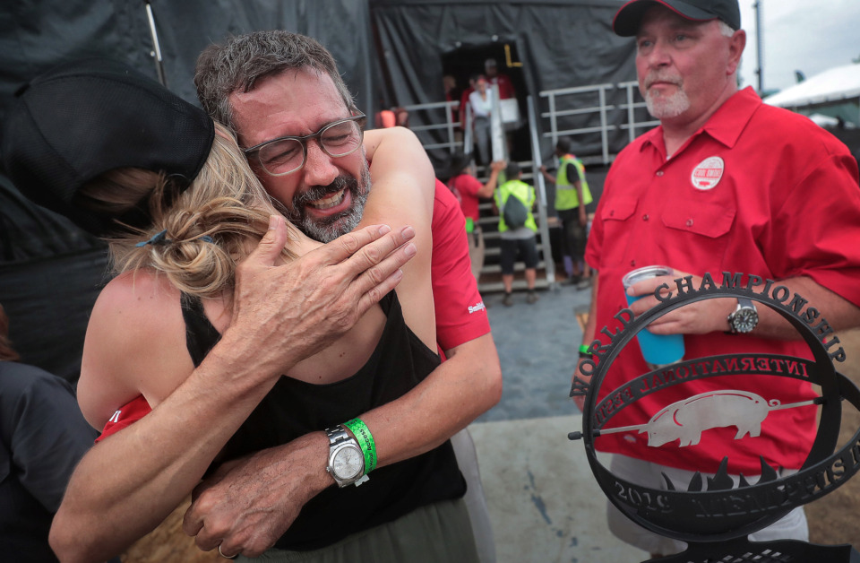 <strong>Pitmaster Tuffy Stone (center) tears up as he leaves the stage after his team, Cool Smoke, was named Grand Champion during the awards ceremony for the 2019 Memphis in May World Championship Barbecue Cooking Contest at Tom Lee Park on May, 18, 2019.</strong> (Jim Weber/Daily Memphian)