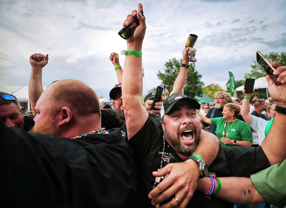 <strong>Hometown BBQ team members celebrate their win in the whole hog division during the awards ceremony on the final day of the 2019 Memphis in May World Championship Barbecue Cooking Contest at Tom Lee Park on May, 18, 2019.</strong> (Jim Weber/Daily Memphian)