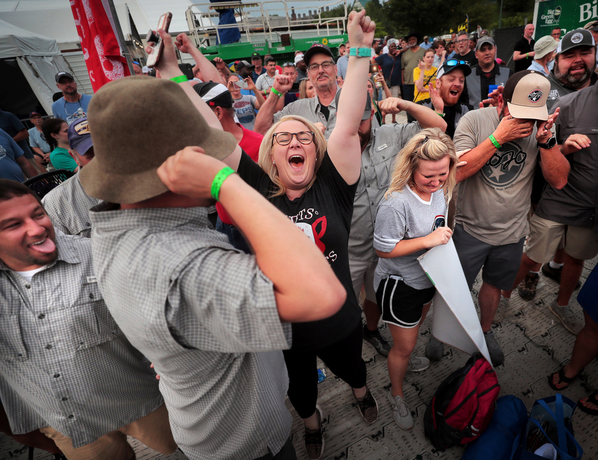 <strong>Nuts N' Butts team members celebrate their win in the ribs division during the awards ceremony on the final day of the 2019 Memphis in May World Championship Barbecue Cooking Contest at Tom Lee Park on May, 18, 2019.</strong> (Jim Weber/Daily Memphian)