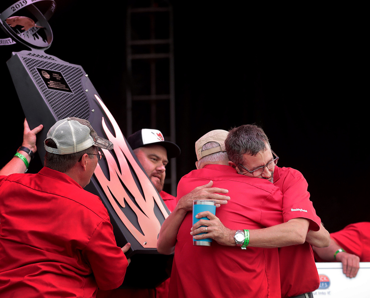 <strong>Pitmaster Tuffy Stone (right) is congratulated by team members after Cool Smoke was named Grand Champion during the awards ceremony for the 2019 Memphis in May World Championship Barbecue Cooking Contest at Tom Lee Park on May, 18, 2019.</strong> (Jim Weber/Daily Memphian)