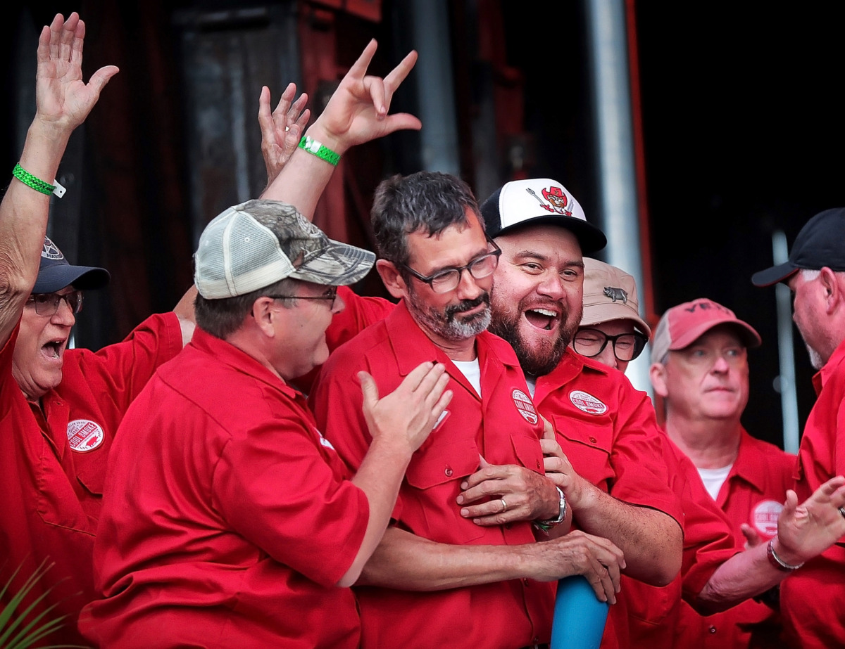 <strong>Pitmaster Tuffy Stone (center) is congratulated by team members after Cool Smoke was named Grand Champion during the awards ceremony for the 2019 Memphis in May World Championship Barbecue Cooking Contest at Tom Lee Park on May, 18, 2019.</strong> (Jim Weber/Daily Memphian)