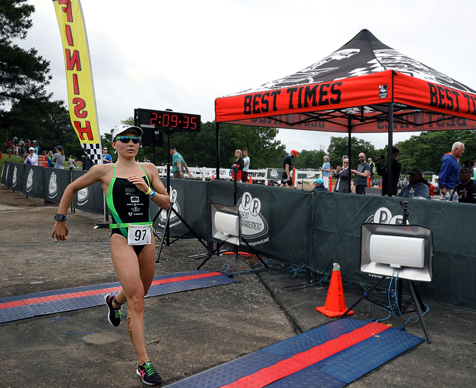 <strong>While she wasn't allowed to officially qualify for the Memphis in May Olympic Triathlon, local pro triathlete Laura Mathews was the first woman to cross the finish line on Sunday, May 19, in Orgill Park in Millington.</strong> (Patrick Lantrip/Daily Memphian)