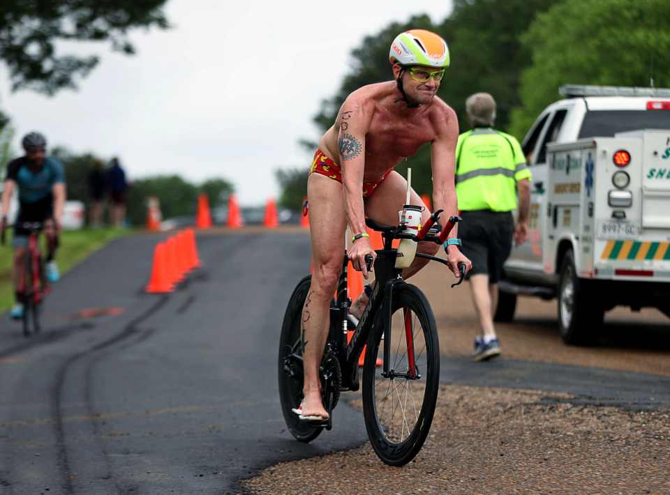 <strong>Joey Lee makes the last turn in the second leg of the Memphis in May Olympic Triathlon on Sunday, May 19.</strong> (Patrick Lantrip/Daily Memphian)