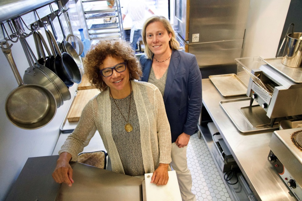 <strong>Diane Terrell (left) and Dr. Heather Jamerson, co-founders of 275 Food Project, in the kitchen of Comeback Coffee. The new coffee shop at 358 N. Main is the latest client of New South Produce Cooperative, a farmers' co-op that will supply the business with locally grown fruit and produce.</strong> (Tom Bailey/Daily Memphian)