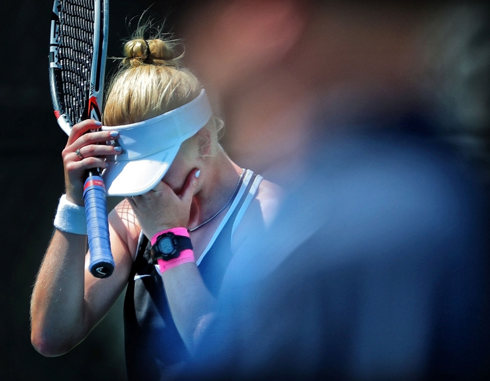 <strong>Grace Anne Dunavant from Hutchison reacts after losing her singles match against Chattanooga Baylor during the TSSAA Division 2-AA state team tennis finals at Spring Fling in Murfreesboro on Wednesday, May 22.</strong> (Jim Weber/Daily Memphian)