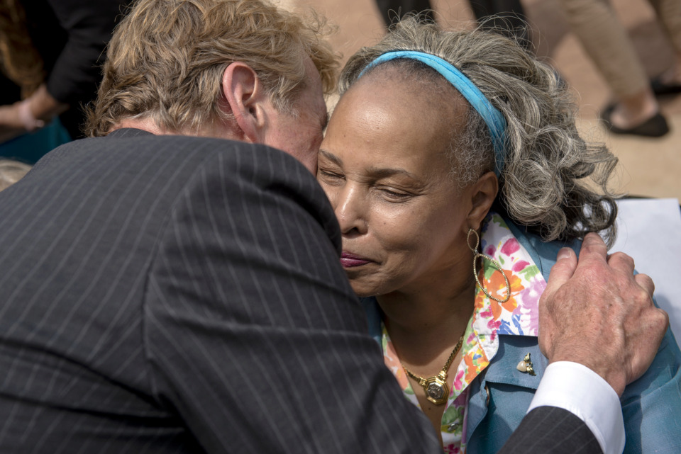 <strong>Memphis Convention and Visitors Bureau president Kevin Kane hugs Vicki Finch, wife of late University of Memphis basketball coach Larry Finch, during the formal announcement of the Memphis Sports Hall of Fame and its first class of inductees at AutoZone Park on May 22, 2019, in Memphis.</strong> (Brandon Dill/Special To The Daily Memphian)