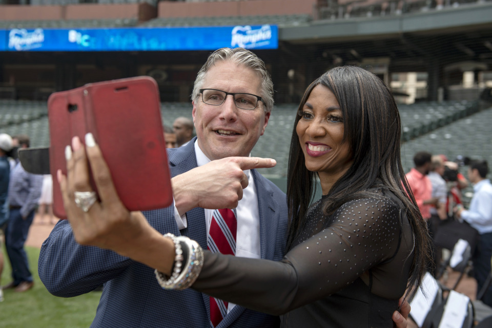 <strong>Pierre Landaiche (left) talks with Olympic gold medalist Rochelle Stevens as she streams a live video during the formal announcement of the Memphis Sports Hall of Fame and its first class of inductees at AutoZone Park on May 22, 2019, in Memphis.</strong> (Brandon Dill/Special To The Daily Memphian)