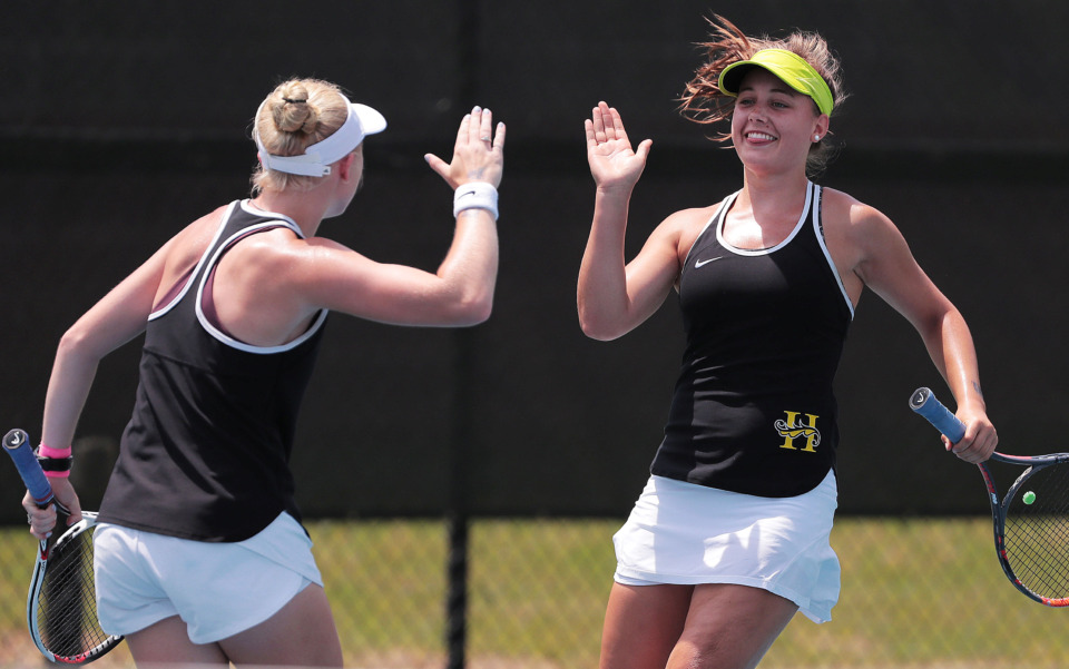 <strong>Grace Anne Dunavant (left) and Anne Grinder from Hutchison celebrate after scoring against Baylor in their doubles match during the TSSAA DIV II state team tennis finals at Spring Fling in Murfreesboro on May 22, 2019.</strong> (Jim Weber/Daily Memphian)