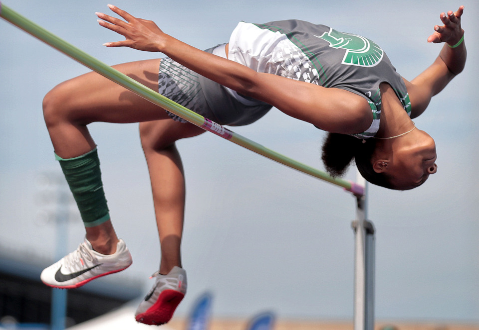 <strong>White Station's Sihira Reese makes an attempt at the 5-foot mark while competing in the AAA high jump during the Spring Fling Class AAA state track finals at MTSU in Murfreesboro on May 23, 2019.</strong> (Jim Weber/Daily Memphian)