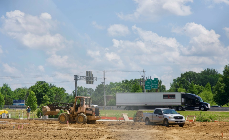 "<strong>A construction crew is building a 71-foot glass-encased tower that will be Carvana's ""car vending machine"" at 7201 Appling Farms Parkway, next to Interstate 40.</strong> (Tom Bailey/The Daily Memphian)"