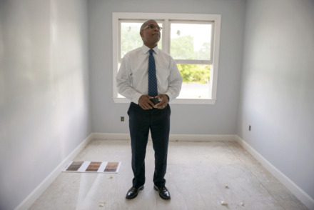 <strong>Knowledge Quest founder and CEO Marlon Foster considers material samples for an apartment building being renovated adjacent to his organization's Green Leaf Learning Farm on May 21, 2019 in Memphis, Tenn.</strong> (Brandon Dill/Special To The Daily Memphian)